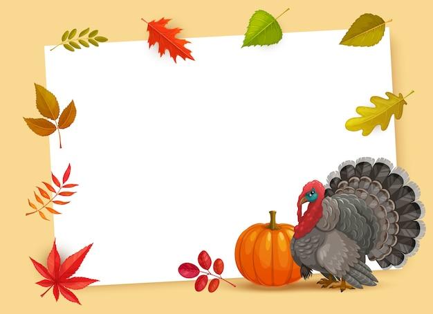 感謝祭のシンボルの七面鳥、カボチャ、秋の落ち葉のフレーム。