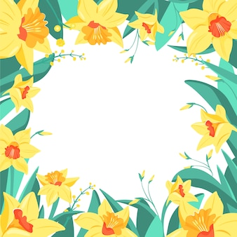 Frame of yellow narcissus flowers and mimosa.