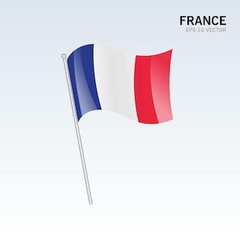 회색 배경에 고립 된 깃발을 흔들며 프랑스