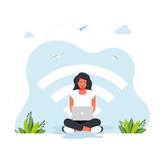 Free wifi zone. public free wifi hotspot zone wireless connection, business concept. woman sitting in lotus position working at a laptop against the background of a large wi-fi icon. freelance concept