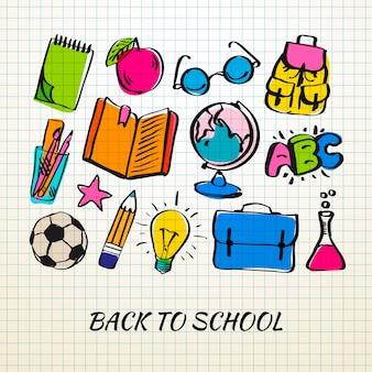 練習帳のシートにフリーハンド描画の学校アイコン。学校に戻る落書き。図。