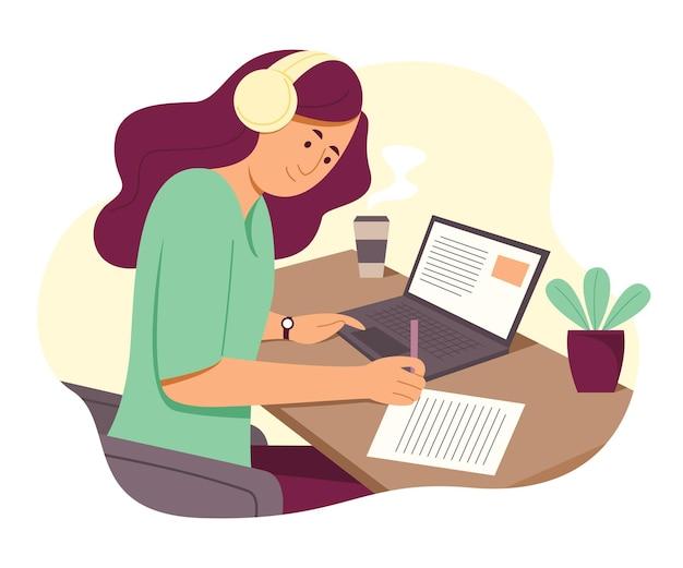 ラップトップで作業し、音楽を聴くフリーランスの女性オンライン