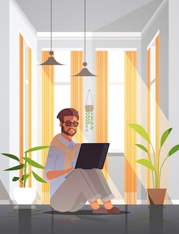 Freelancer using laptop man working from home self-isolation coronavirus pandemic quarantine concept