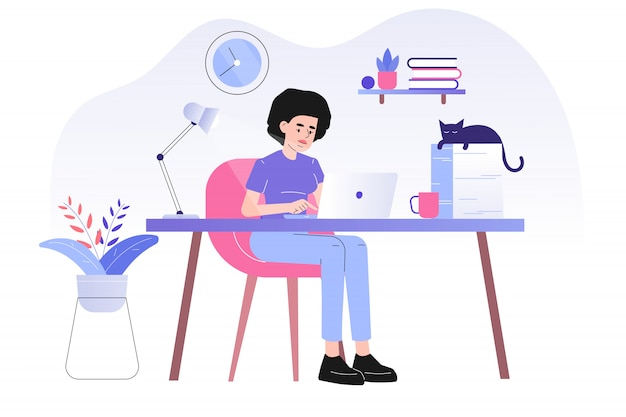 Freelancer woman sitting on a desk and working online with a laptop at home