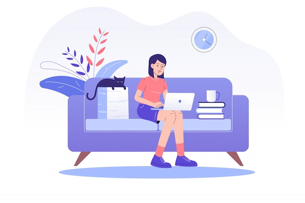 Freelancer woman sitting on sofa and working online with a laptop at home