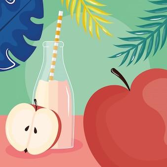 Fresh apple juice fruit in botttle with straw in leafs palms