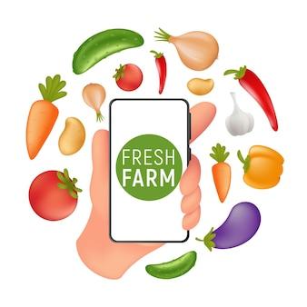Продуктовый рынок fresh farm. онлайн-заказ и доставка еды и напитков. человеческая рука, держащая мобильный смартфон с натуральными овощами на экране.