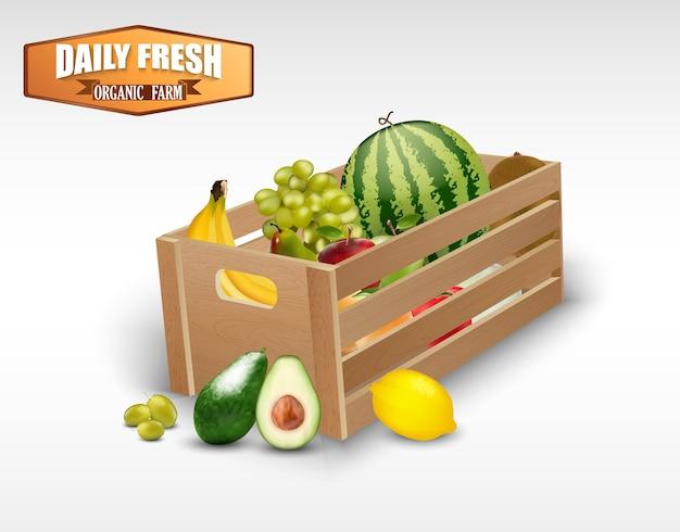 白い背景に木製の箱で新鮮な果物
