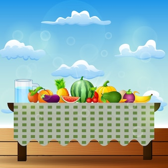 Fresh fruits on table with blue sky background