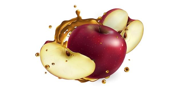 Свежие красные яблоки и всплеск фруктового сока.