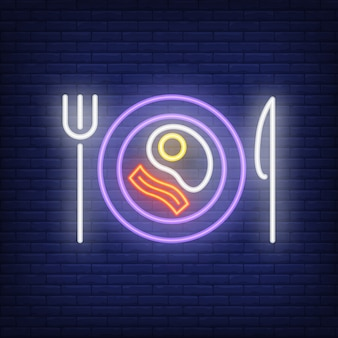 Fried egg and bacon on plate with knife and fork neon sign