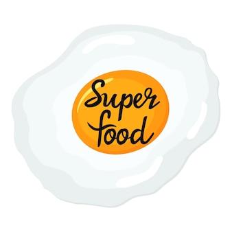 Жаренное яйцо. супер еда рисованной надписи. концепция питания.