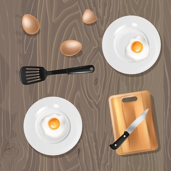 Fried eggs cooked breakfast food on plates on table