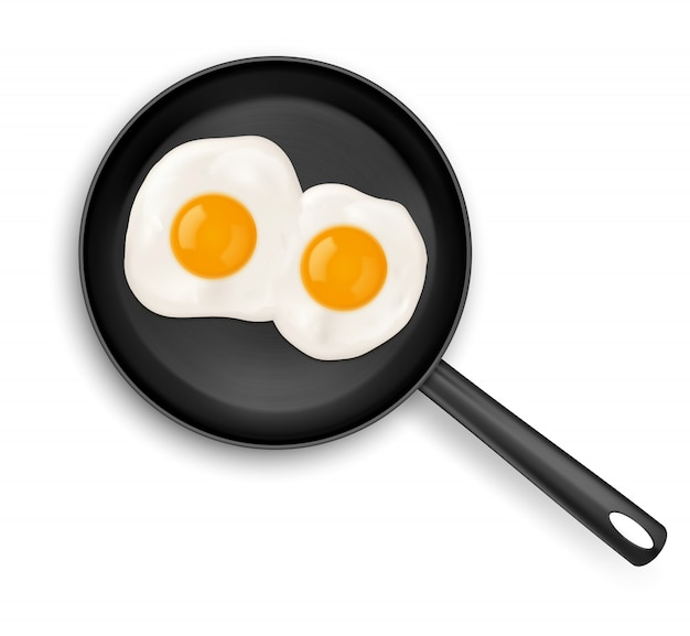 Fried eggs on frying pan top view isolated