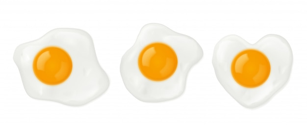 Fried eggs in heart shape top view