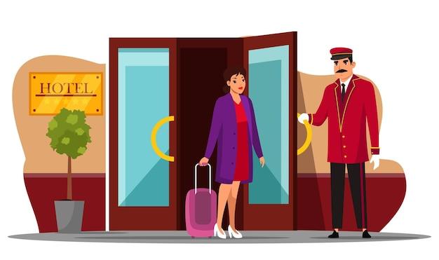 フレンドリーな笑顔のポーター男がホテルのゲストのドアマンのコンシェルジュキャラクターに会うスーツの制服の挨拶の女性が訪問者のための入り口のドアを開く