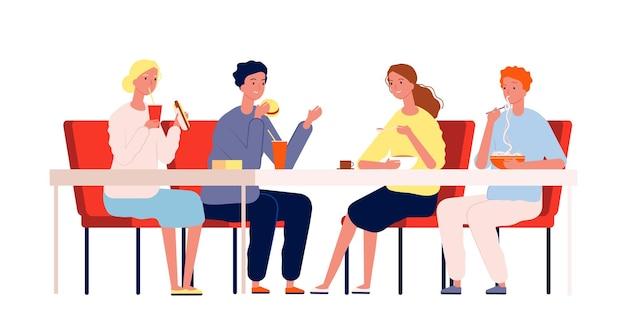 食べる友達。幸せな人々が集まり、レストランのテーブルに座って夕食をとります