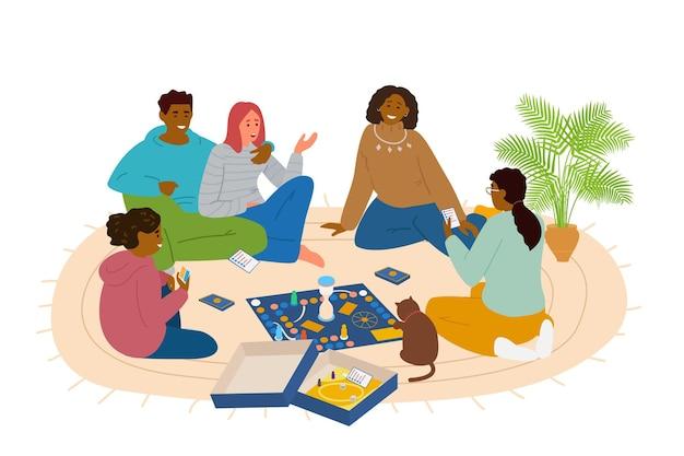 Друзья играют в настольную игру дома, сидя на полу