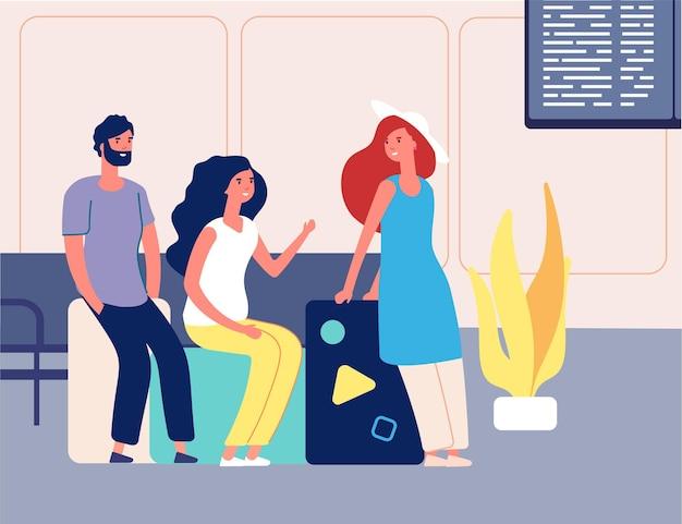 Друзья путешествуют. мужчина женщина с чемоданами ждет транспорт путешествия. люди в аэропорту или на вокзале
