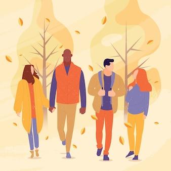 秋の公園で歩いている友人