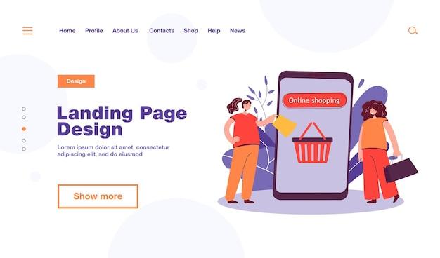 Друзья с сумками покупают одежду в интернете. крошечные женские персонажи, телефон с плоской иллюстрацией веб-сайта. интернет-магазины, технологическая концепция, дизайн веб-сайта или целевая веб-страница