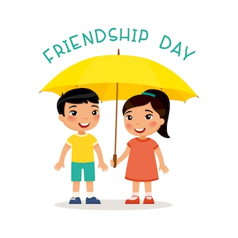 Friendship day.  cute little asian boy and girl stand with an umbrella