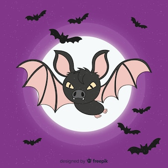 Front view of angry bat with full moon