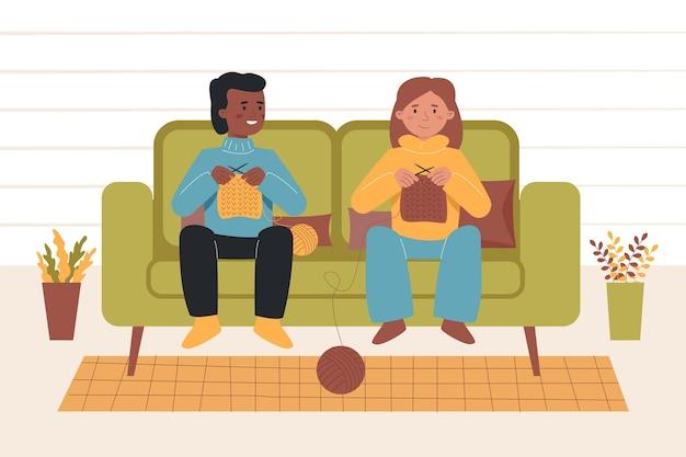 居間で一緒に編み物をしている正面図
