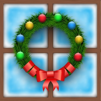 Frosted window with christmas wreath. merry christmas holiday card. square wooden window.