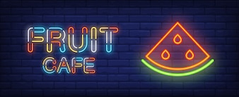 Fruit cafe neon sign. Colorful text and slice of watermelon on brick wall background