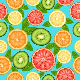 カットトップビュー柑橘類とキウイとフルーツのシームレスパターン