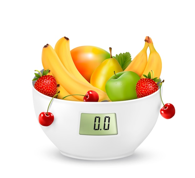 Фрукты с цифровыми весами. концепция диеты.