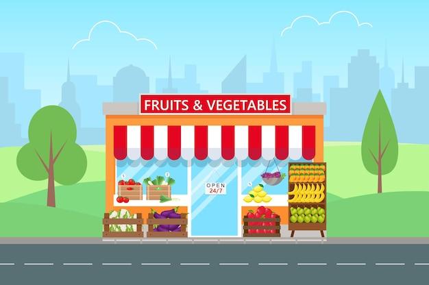 Магазин фруктов и овощей в плоском стиле. фасад продуктового магазина. большой город на фоне.