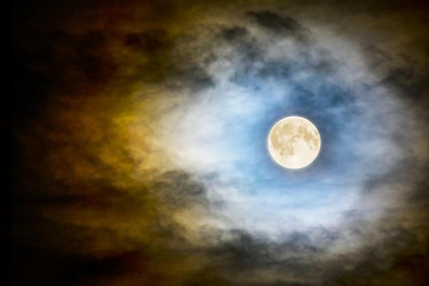 Full vector moon over dark cloudy midnight sky. spooky moonlight halloween background