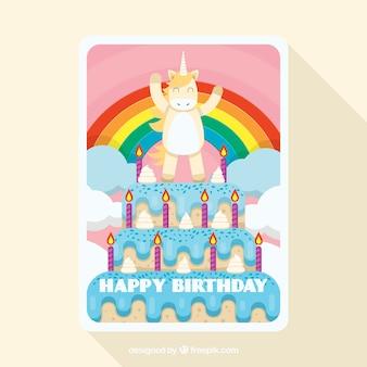 Cartolina di compleanno divertente con un unicorno su una torta