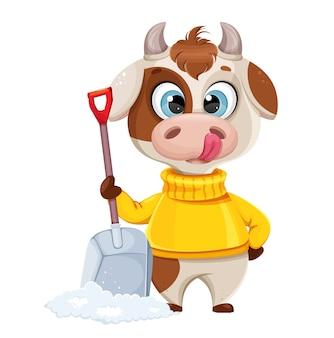 Забавный бык, держащий лопату для снега
