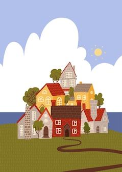 海沿いの面白い漫画の町。居心地の良い家と木が積み上げられました。