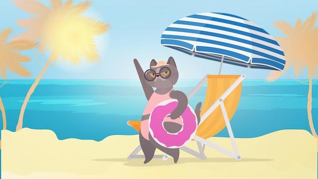 Забавный кот с розовым плавательным кругом