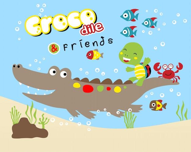 Funny crocodile cartoon with little friends Premium Vector
