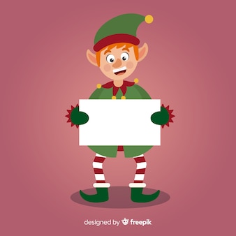 Funny elf holding blank sign