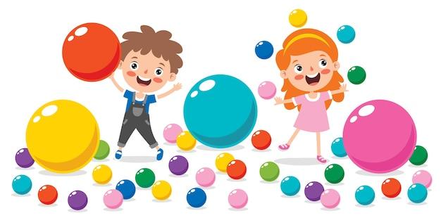다채로운 공을 가지고 노는 재미있는 아이