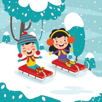 冬の季節に楽しんでいる面白い子供たち