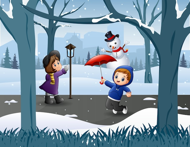 Funny kids playing in the snowy park
