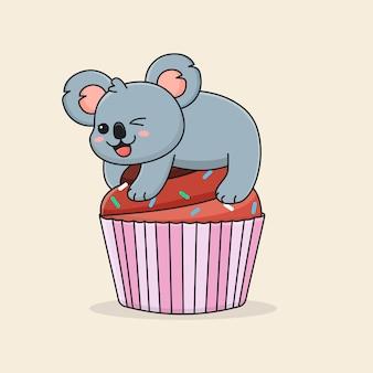Funny koala on chocolate cupcake