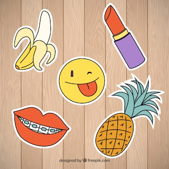 Funny patches on wooden background