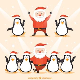 Funny santa claus and penguins dancing