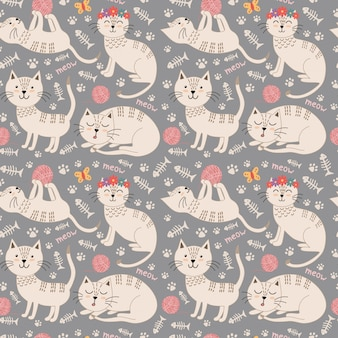 Funny seamless pattern with cute cats.