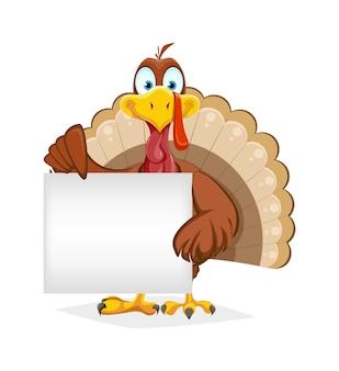 空白のプラカードを保持している面白い感謝祭のトルコの鳥