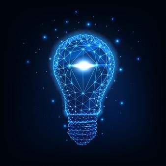 Futuristic glowing low polygonal light bulb isolated on dark blue .