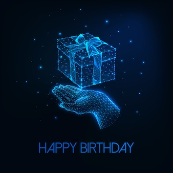 Futuristic happy birthday greeting card with glowing low polygonal human hand holding gift box